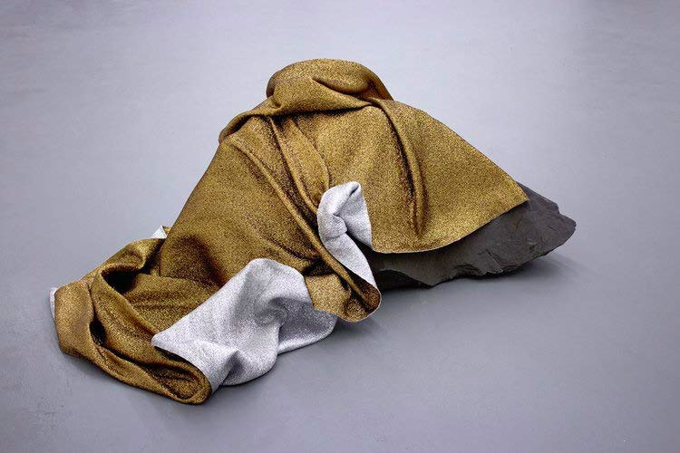 Sarah Nance, (emergency) (space) blanket for the moon, 2016. Hand-woven bronze and silver mylar thread, rundle boulder 22.5 x 51 x 35.5 in. Courtesy artiste
